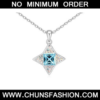 Ocean Blue sparkly four pointed star pendant